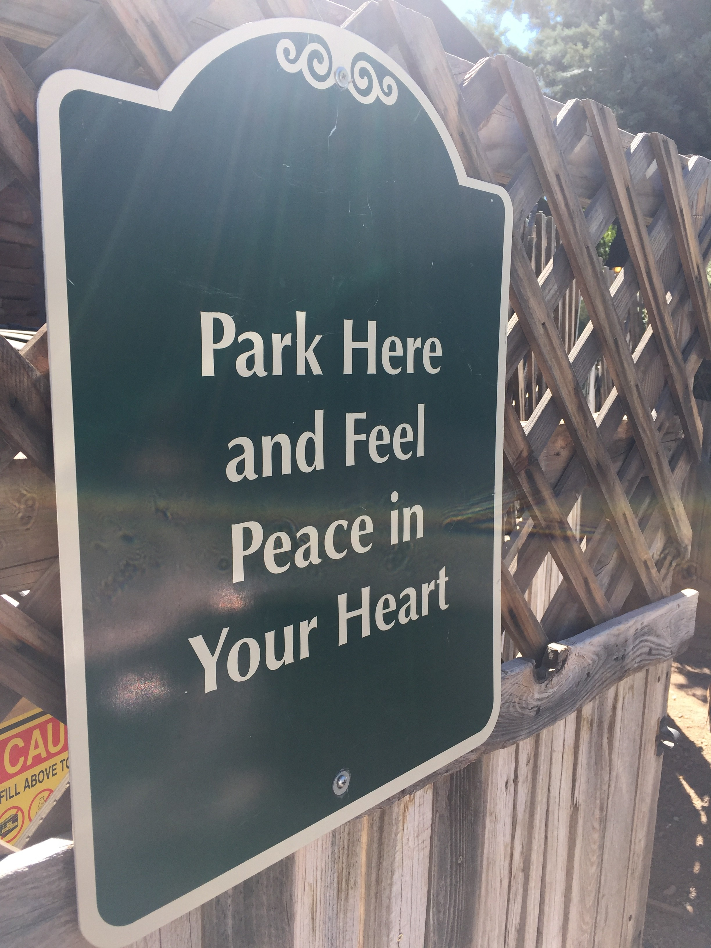 sign: park here and feel peace in your heart