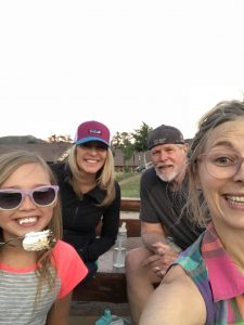 family of four eating smores